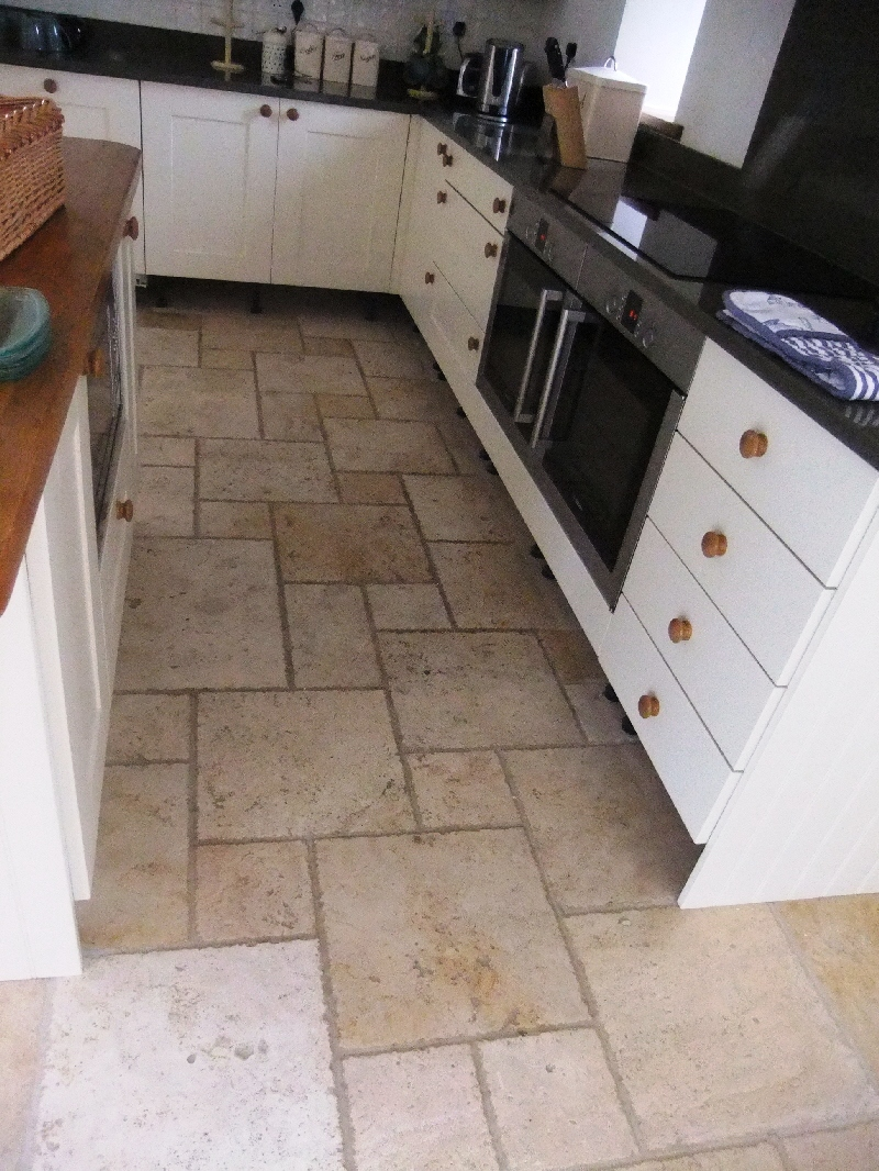 Stone cleaning and polishing tips for travertine floors the photographs above show travertine stone tiles on a kitchen floor before and after cleaning and sealing dailygadgetfo Image collections
