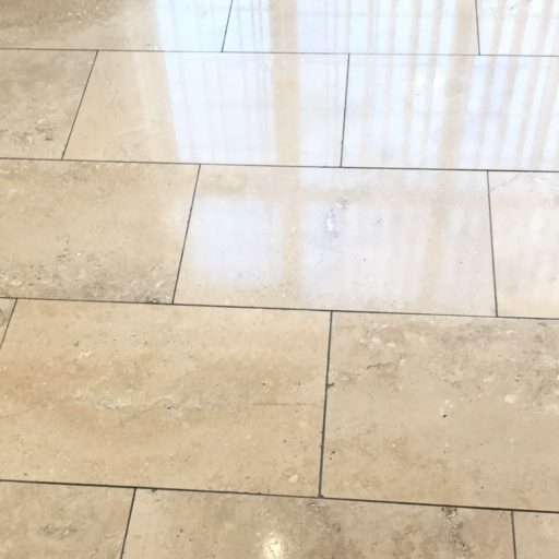 Renovating Pitted Travertine Floor Tiles In A
